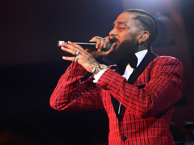 in this file photo taken on february 07 2019 nipsey hussle and lauren london arrive at the warner music group pre grammy celebration at nomad hotel los angeles   grammy nominated rapper nipsey hussle was fatally shot in the us city of los angeles on sunday march 31 2019 nbc news reported citing law enforcement sources afp