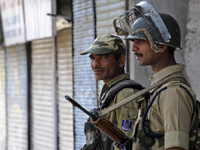 indian paramilitary soldiers stand guard during a curfew photo afp