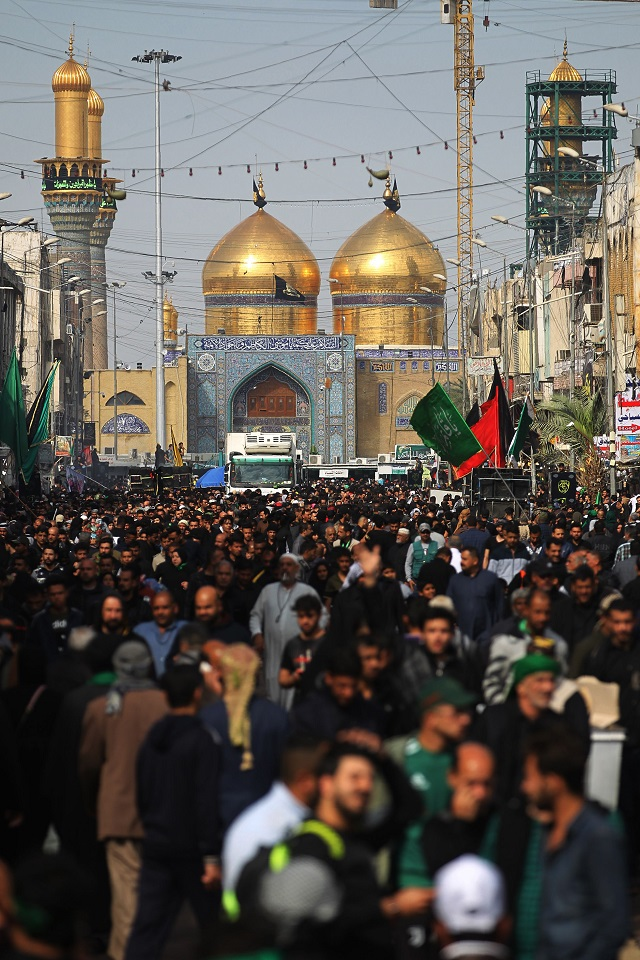 shiite muslim pilgrims march outside the imam musa al kadhim mosque in the iraqi capital s northern district of kadhimiya on april 2 2019 as they prepare to mark later this week the anniversary of the seventh shiite imam 039 s death in the 8th centry photo afp