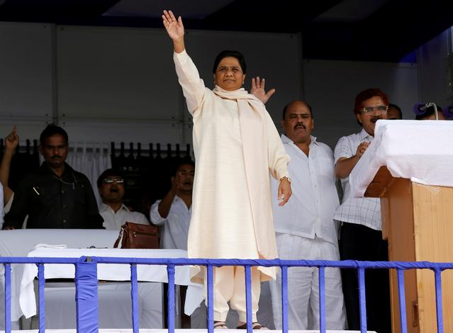 the bahujan samaj party bsp chief mayawati waves to her supporters during an election campaign rally on the occasion of the death anniversary of kanshi ram founder of bsp in lucknow india photo reuters