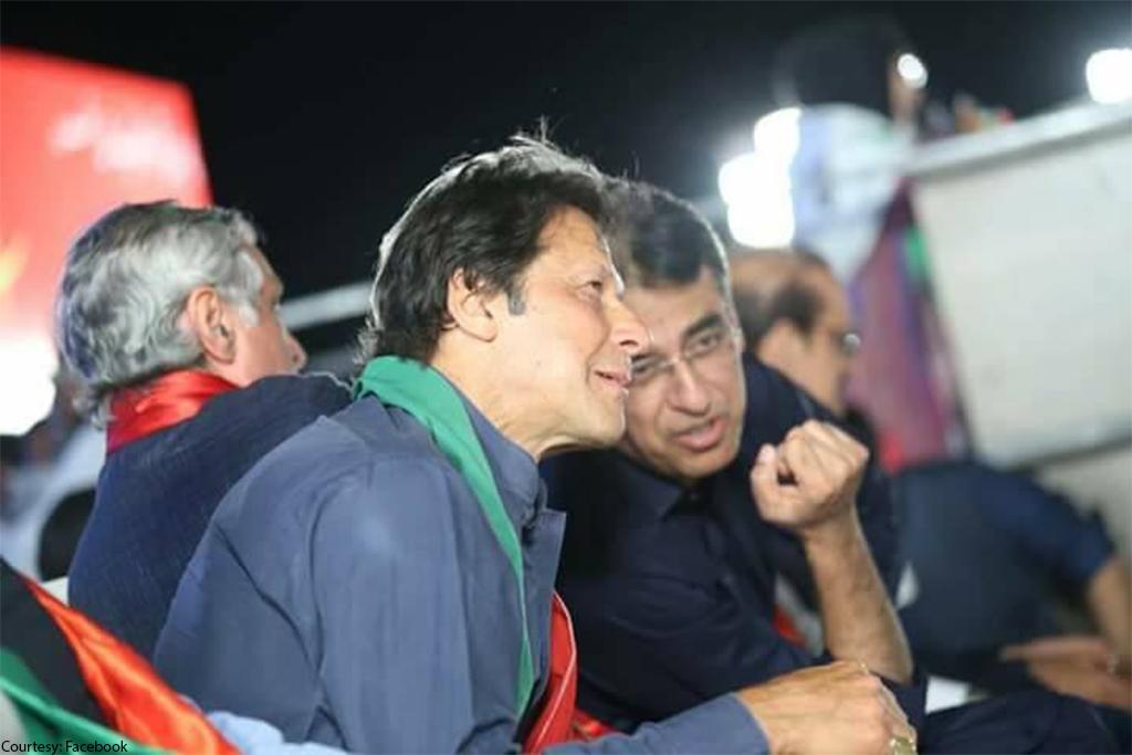pm imran khan listens as finance minister asad umar speaks photo pti