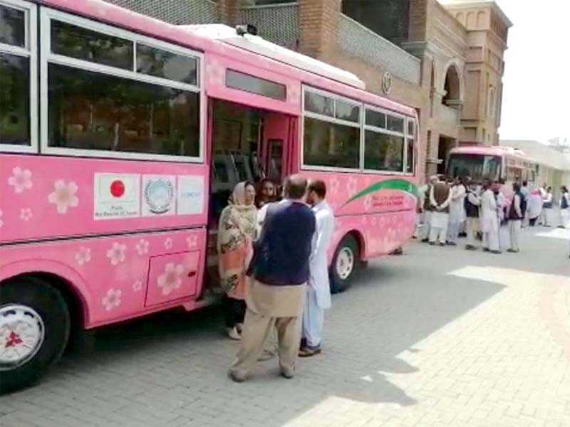 Guests look at a pink bus during the launching ceremony on Thursday in Mardan. PHOTOS: EXPRESS