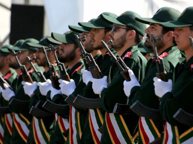 iranian soldiers from the revolutionary guards march march at a military parade in tehran photo afp