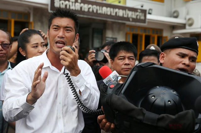 thanathorn juangroongruangkit leader of the future forward party speaks to his supporters as he arrives at a police station to hear a sedition complaint filed by the army in bangkok thailand april 6 2019 photo reuters