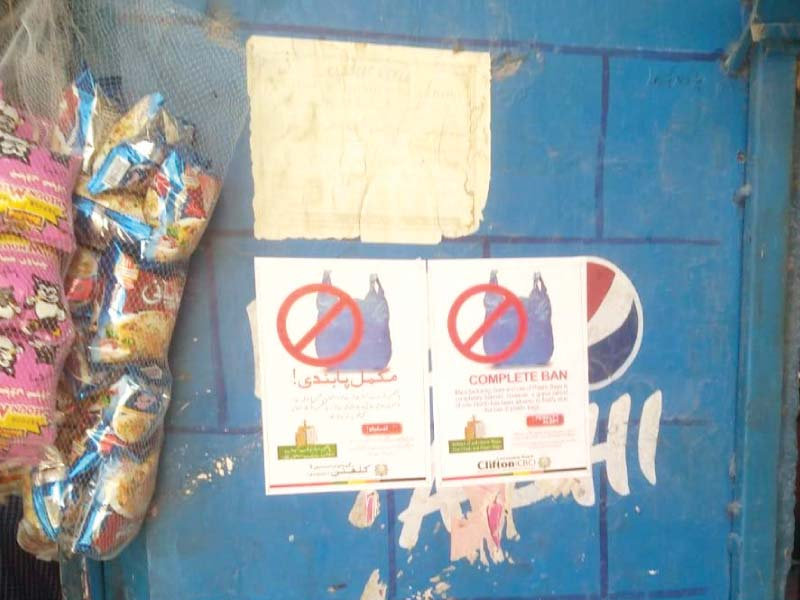 posters placed outside shops in clifton area warn against the use of plastic bags those who fail to comply will face heavy fines photo express