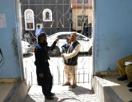 a security guard stands on duty as a patient waits outside the opd section of civil hospital quetta during doctors strike in the province photo express