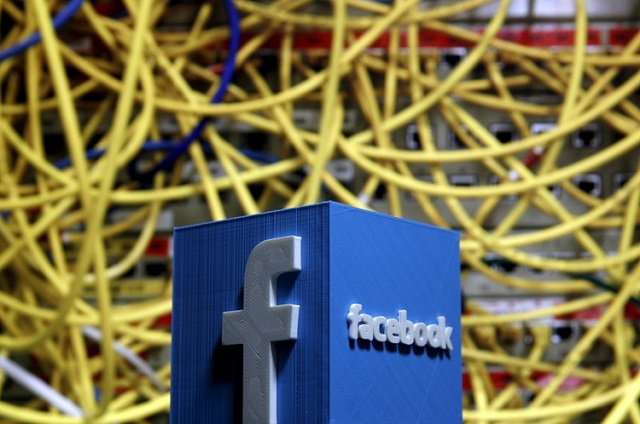 a 3d plastic representation of the facebook logo is seen in front of displayed cables in this illustration in zenica bosnia and herzegovina may 13 2015 photo reuters