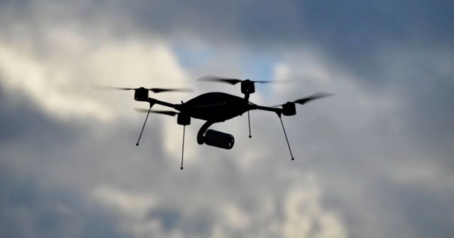 a drone silhouettes against the cloudy sky a google linked firm will start delivering takeaways and other small items to canberra residents after the company received approval from aviation watchdogs in australia photo afp