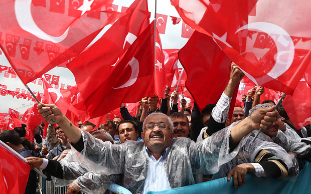 supporters cheer turkey 039 s president recep tayyip erdogan as he addresses an election rally in golbasi photo afp