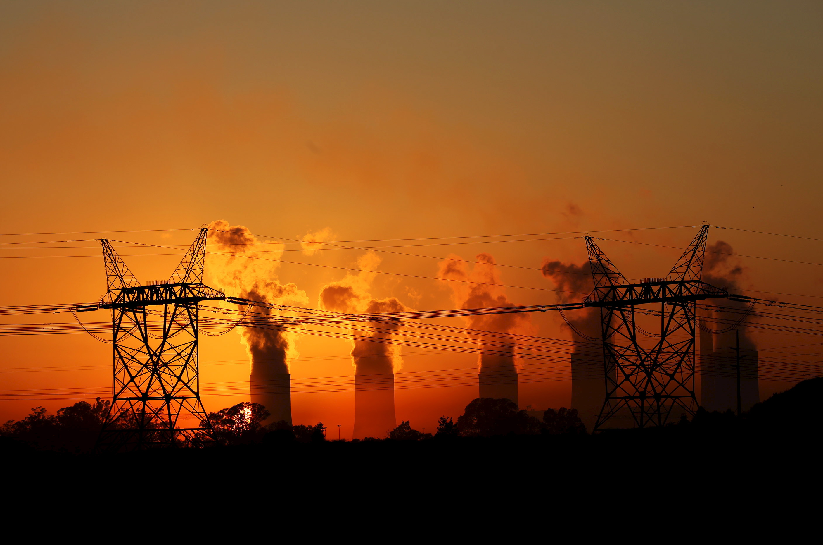 electricity pylons are seen in front of the cooling towers photo reuters