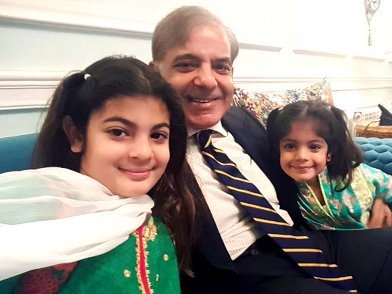 a file photo of shehbaz sharif with his grandchildren photo shehbaz sharif