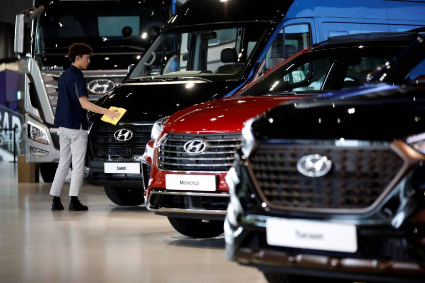 a staffer polishes hyundai vehicles at a showroom in goyang south korea last month photo reuters
