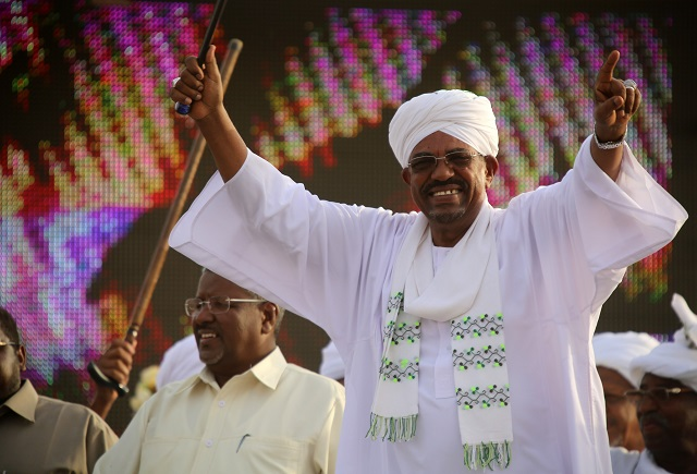sudan 039 s president omar al bashir and then presidential candidate of the ruling national congress party ncp waves in the capital khartoum photo afp