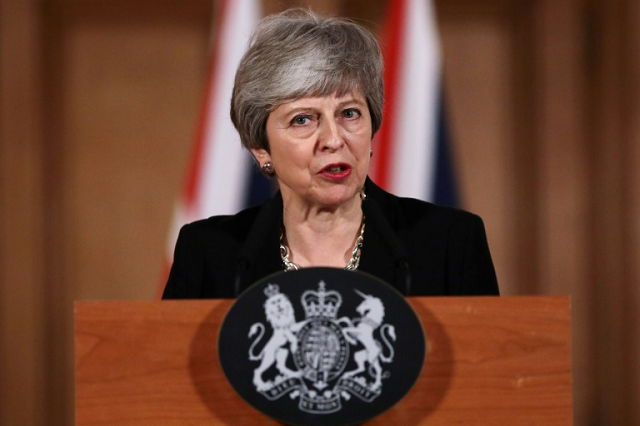 british pm may defends brexit delay critic asks her to resign photo afp
