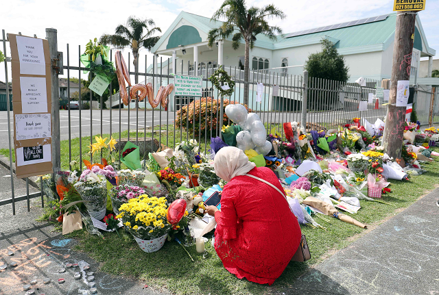 residents pay their respects by placing flowers for the victims of the mosques attacks in christchurch at the masjid umar mosque in auckland on march 17 2019 photo afp