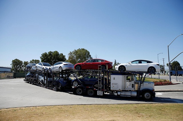 a car carrier trailer carries tesla model 3 electric sedans is seen outside the tesla factory in fremont california us june 22 2018 photo reuters
