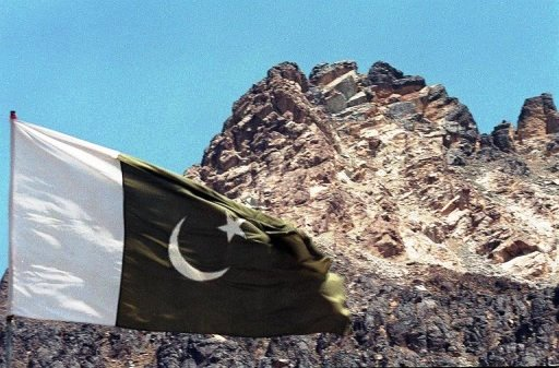 pakistan 039 s national flag flies near the hill under which the country 039 s five nuclear tests were carried out photo afp