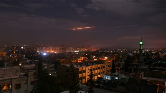 a file photo taken early on january 21 2019 shows syrian air defense batteries responding to israeli missiles targeting damascus photo afp