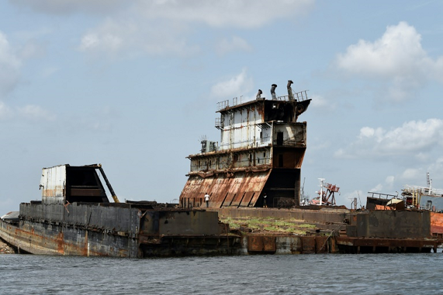 Graveyard: Dozens of shipwrecks and abandoned barges litter the Lagos waterways. PHOTO: AFP