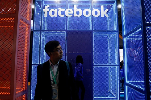 A Facebook sign is seen during the China International Import Expo (CIIE), at the National Exhibition and Convention Center in Shanghai, China November 5, 2018. PHOTO: REUTERS