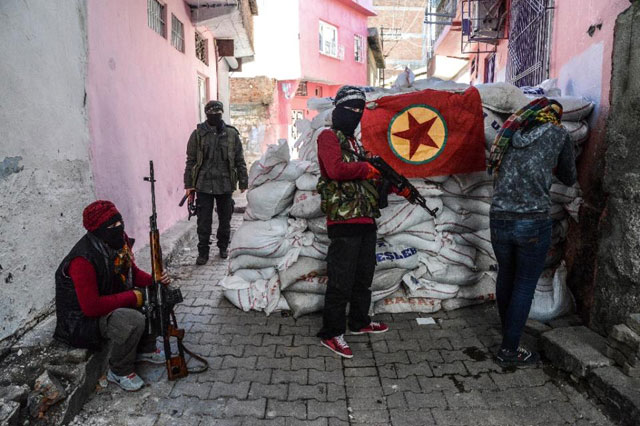 a kurdish workers party pkk flag hangs on a barricade in the sur district of diyarbakir southeastern turkey on november 18 2015 photo afp