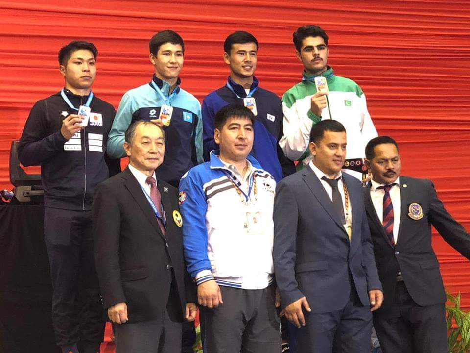 Owais (Upper row, right corner) posing with his medal. PHOTO COURTESY: PKF