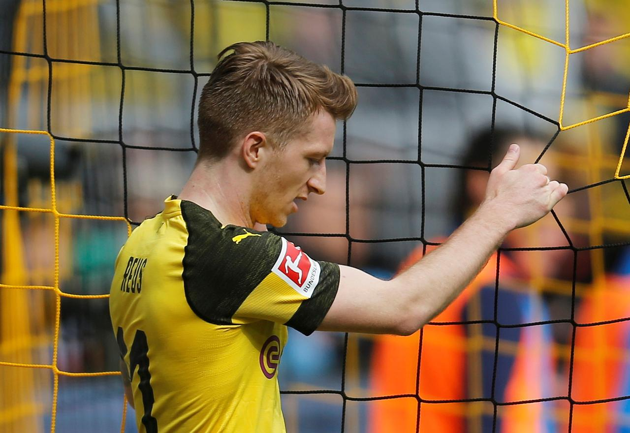 dortmund s reus banned for two matches wolf for three