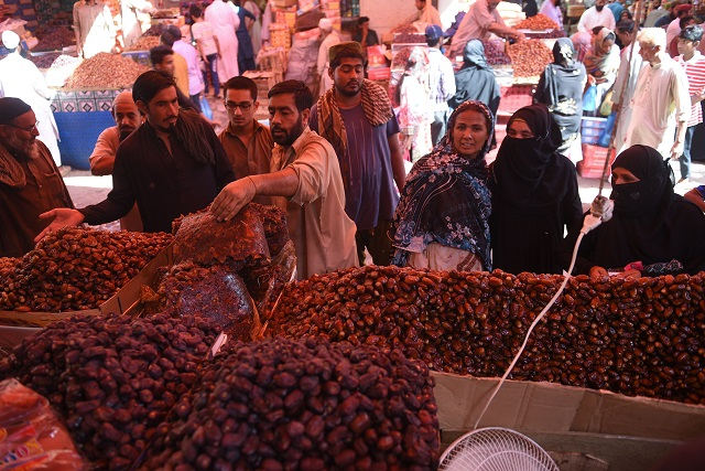 Citizens buying dates at a market in Karachi. PHOTO: AFP