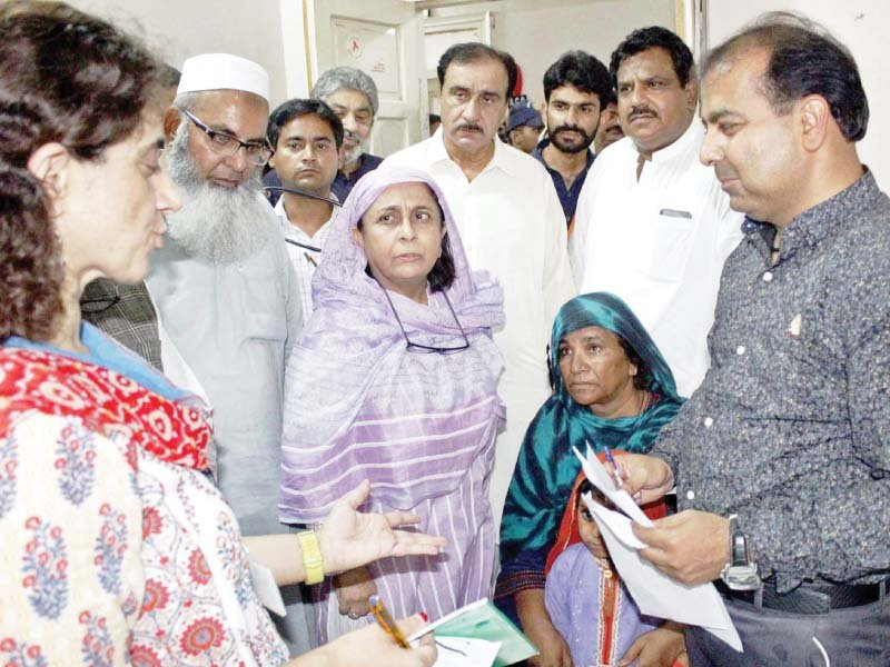 Dr Azra Pechuho enquires about the health of patients during her visit to Chandka Medical College Hospital in Larkana on Tuesday. PHOTO: PPI