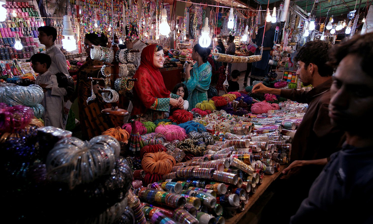 a woman buy bangles and jewellery at a stall ahead of eid al fitr in islamabad photo reuters