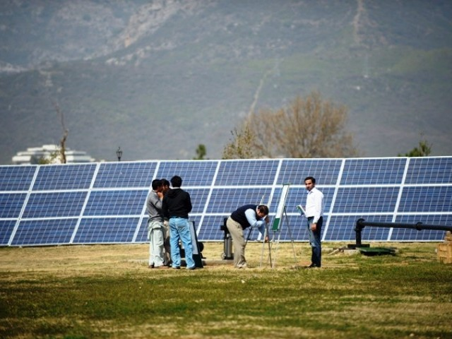 Representational image of solar panels being installed. PHOTO: AFP