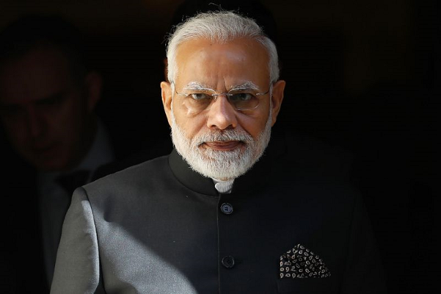The 68-year-old Narendra Modi makes much of his humble roots while unashamedly portraying himself as the tough guy protecting India's national security and Hindu values. PHOTO: AFP