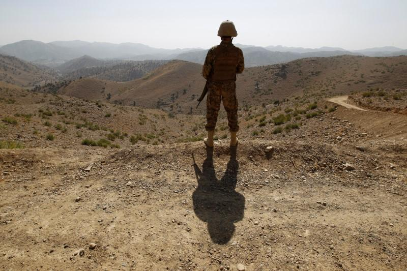 A soldier stands guard outside the Kitton outpost along the border fence on the border with Afghanistan in North Waziristan, Pakistan October 18, 2017. PHOTO: REUTERS