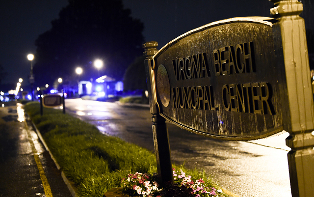 """The Virginia Beach municipal center sign is seen in Virginia Beach, Virginia in the late hours of May 31, 2019. - A municipal employee sprayed gunfire """"indiscriminately"""" in a government building complex on Friday in the US state of Virginia, police said, killing 12 people and wounding four in the latest mass shooting to rock the country. PHOTO: AFP"""