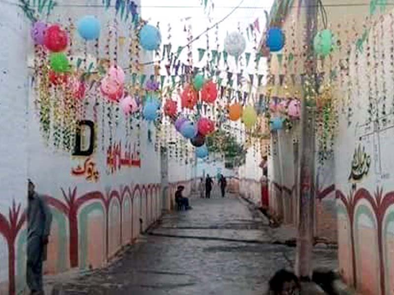 Balloons and painted walls add colour to the Nowshera locality. PHOTO: EXPRESS