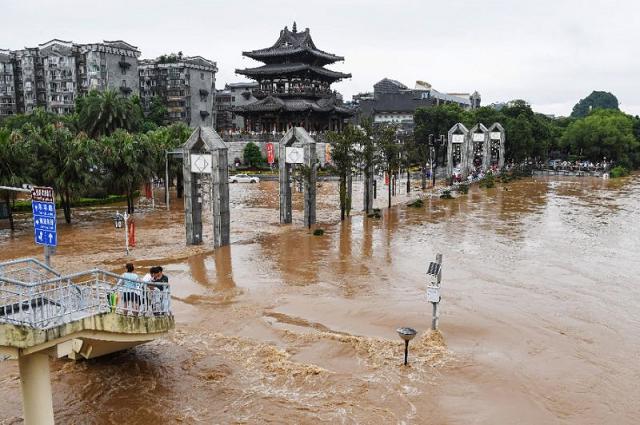 china flooding kills at least 19 state media
