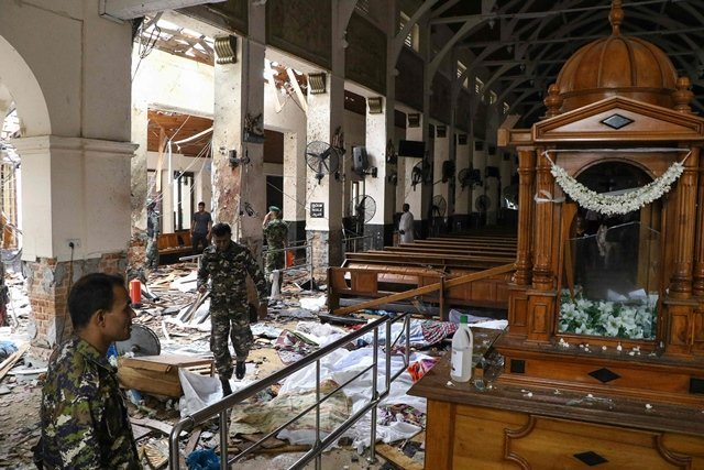 Sri Lankan security personnel stand amid blast debris at St Anthony's Shrine following an explosion in the church in Kochchikade in Colombo on April 21. PHOTO: AFP