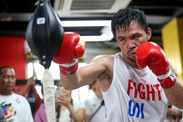 pacquiao risking brain damage by fighting on