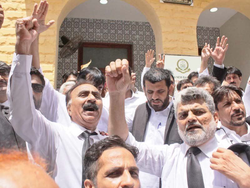 Lawyers of Pakistan Bar Council and Supreme Court Bar Association shouted slogans against filing of references against the two judges of the Supreme Court. PHOTO: ONLINE
