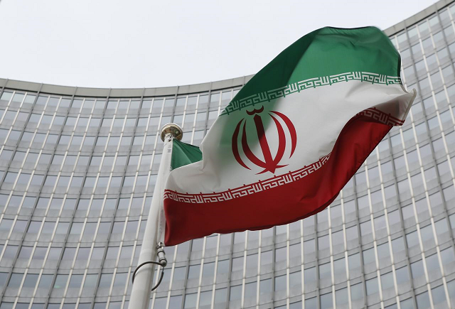 An Iranian flag flutters in front of the International Atomic Energy Agency (IAEA) headquarters in Vienna, Austria. PHOTO: REUTERS