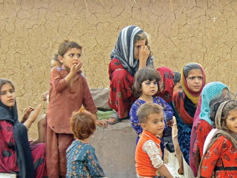 Afghan children sit outside their mud house in a refugee camp in Islamabad. PHOTO: ZAFAR ASLAM/EXPRESS