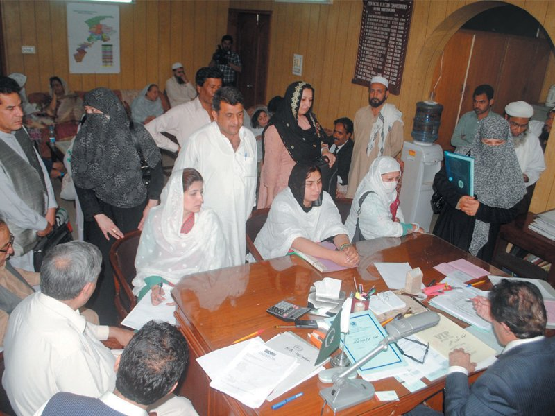 Scrutiny process of women candidates under way at a provincial office of the Election Commission of Pakistan. PHOTO: MUHAMMAD IQBAL/EXPRESS