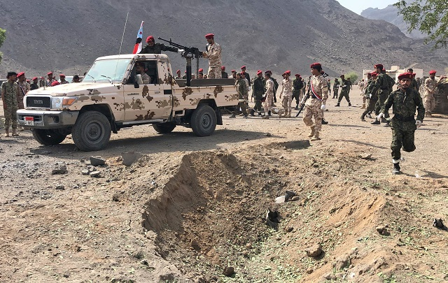 Yemeni security forces gather at the scene of a missile attack on a military camp west of Yemen's government-held second city Aden, on August 1, 2019. PHOTO: AFP