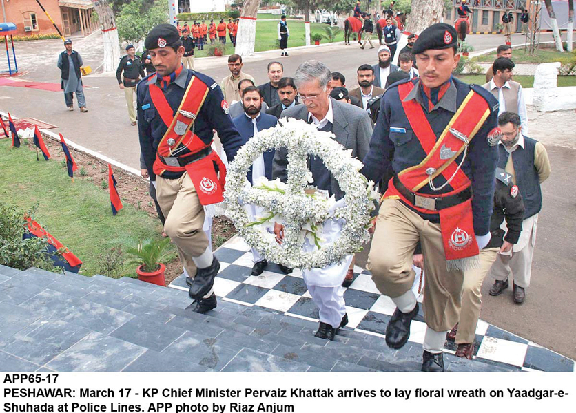 The chief minister laid floral wreaths at monuments of police martyrs at Malik Saad Police Lines. PHOTO: APP