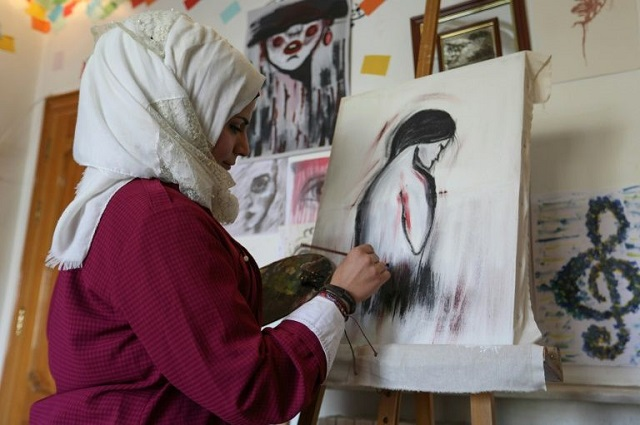Through her cartoons, Amani al-Ali has boldly challenged traditions (Photo: AFP Photo/Omar HAJ KADOUR)