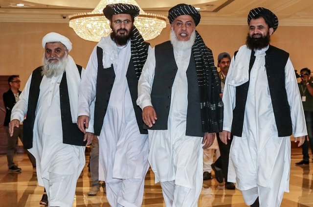 Taliban members enter talks with Afghan representatives in Qatar. PHOTO: AFP/FILE