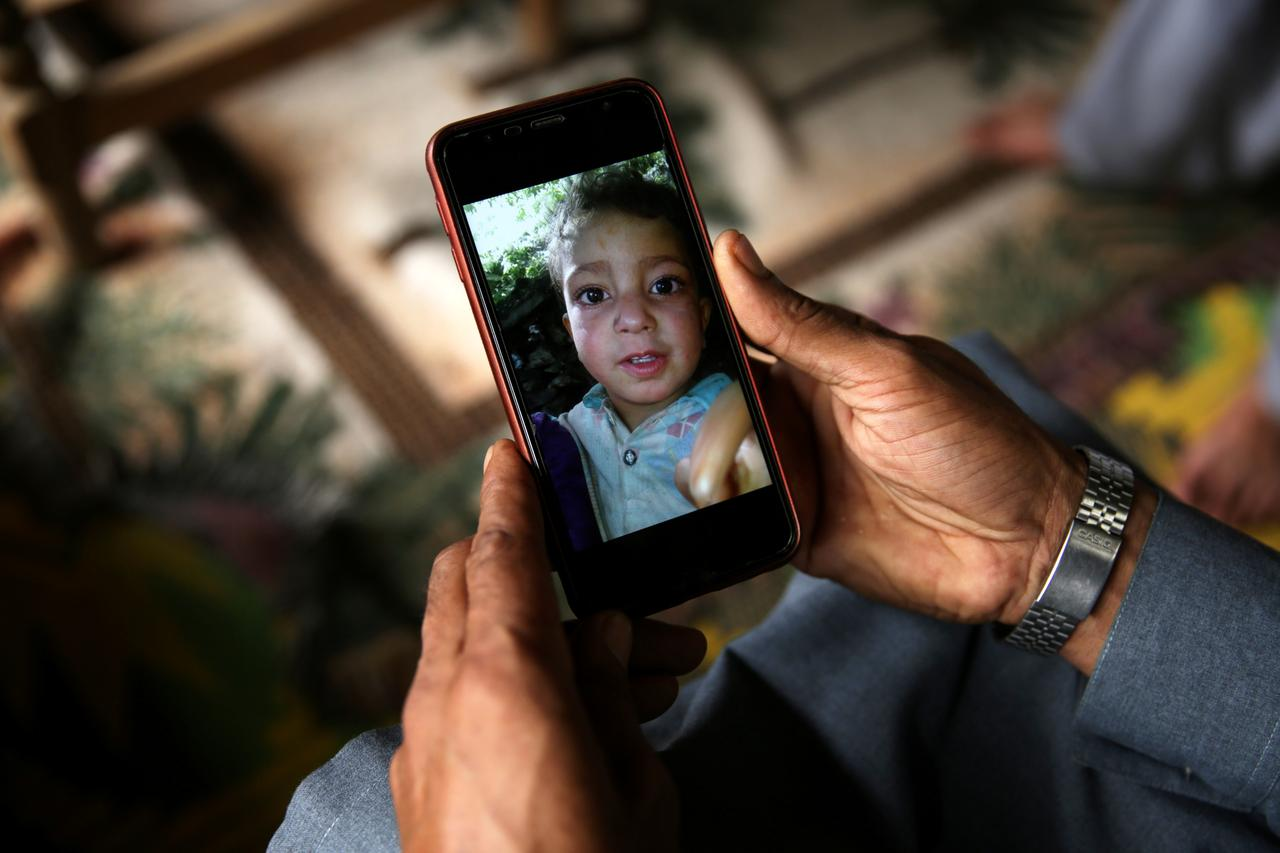 Relative displays picture of 4-year-old Mohammad Ayan Ali, who, found a device that looked like a toy and exploded in his hands at home. PHOTO: REUTERS