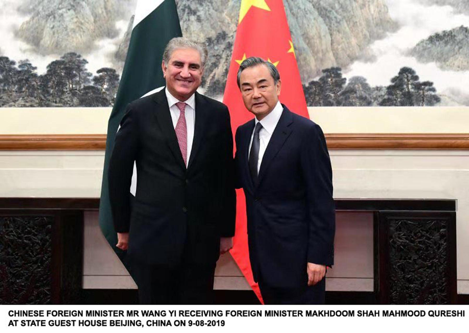 foreign minister shah mehmood qureshi with chinese counterpart wang yi in beijing photo pid