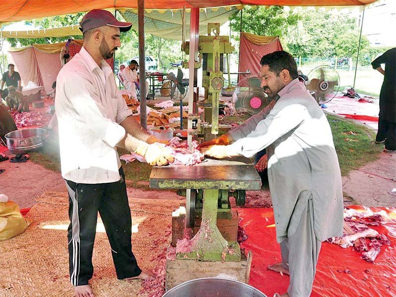 Butchers use machines to cut beef on Eidul Azha. PHOTO: APP