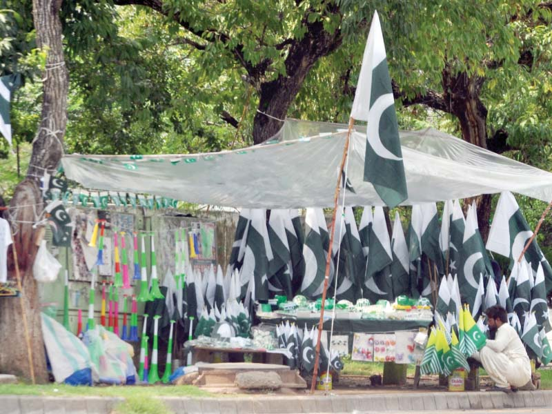 A vendor sells national flags in Islamabad. PHOTO: EXPRESS